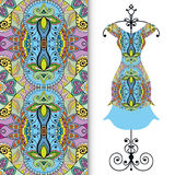 Women's dress on a hanger and seamless geometric pattern Royalty Free Stock Photos