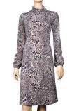 Women`s dress with leopard pattern. Isolate on white. Dressed on a mannequin Royalty Free Stock Images