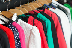 Women's dresses on hangers in a retail shop Royalty Free Stock Image