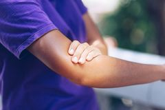 Women`s elbow pain royalty free stock photo