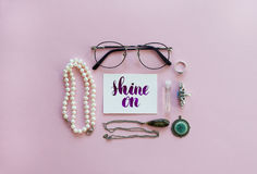 Women`s fashion accessories arrangement on a pink background Royalty Free Stock Images
