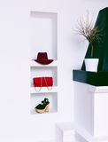 Women's fashion accessories in white interior. Hat, clutch and s Stock Photography