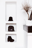 Women's fashion accessories in white interior. Hats, bags, shoes. Black style in clothes Royalty Free Stock Photography