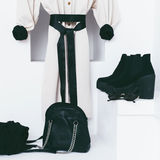 Women's fashion accessories in white interior. Stock Photos