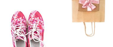 Women`s fashion sneakers pink on a white background. royalty free stock image