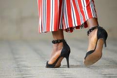 Women`s feet in heels. The a women`s feet in heels stock photo
