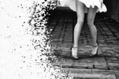 Women`s feet in heels in a dark alley of the city.  royalty free stock images