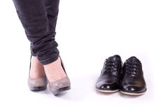 Women's feet and men's shoes Stock Photo