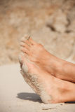 Women's feet in the sand Royalty Free Stock Image