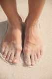 Women's feet in the sand Royalty Free Stock Photo
