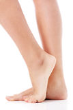 Women's feet on white background. Women's feet isolated on white background