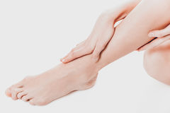 Women`s feet on white background.