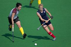 Women's field hockey. Action during an annual women's field hockey match between the North West University (NWU) and the University of the Free State (UFS) Stock Photography