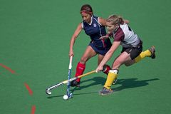 Women's field hockey. Action during an annual women's field hockey match between the North West University (NWU) and the University of the Free State (UFS) Royalty Free Stock Image