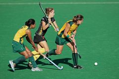 Women's field hockey. Ilse Davids, N Nelen and Dirkie Chamberlain in action during a women's field hockey match between South Africa and Belgium (South Africa Stock Image