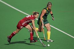 Women's field hockey. Charlotte de Vos and Tarryn Bright in action during a women's field hockey match between South Africa and Belgium (South Africa won 3-2) Royalty Free Stock Images