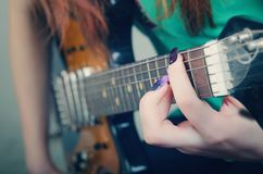 Girl playing the guitar Royalty Free Stock Photography