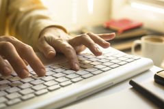 Women's fingers typing on laptop keyboard. Work. Stock Images