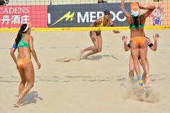 A women's FIVB World Tour game in progress. Beach volleyball is a game which has achieved worldwide popularity. Photo taken October 27, 2013, a women's FIVB Royalty Free Stock Photography