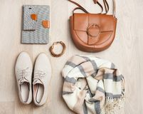 Women`s flat lay clothes shoes, scarf, bracelet, bag, tablet, sm Stock Photos