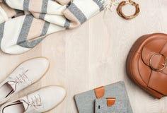 Women`s flat lay clothes shoes, scarf, bracelet, bag, tablet, sm Stock Images