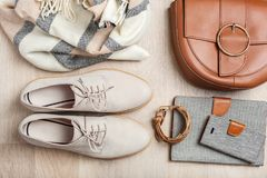 Women`s flat lay clothes shoes, scarf, bracelet, bag, tablet, sm Royalty Free Stock Photography