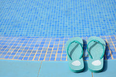 Women's flip flops near tropical pool Royalty Free Stock Images