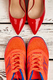 Women`s footwear for different occasions. Time for sport and romance Royalty Free Stock Photo