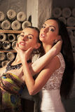 Women's friendship. Two girls, youth, beauty, blonde and brunette, opposition hold each other's hair, of Yin and Yang, the eternal battle between good and evil royalty free stock photo