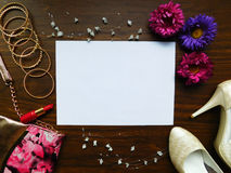 Women`s glamorous composition. Glamorous composition made of woman`s accessories, lipstick and shoes stock photography