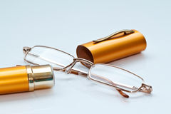 Women's glasses with yellow metal containers. Close up Stock Photos