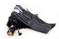 Women's gloves and parasols Royalty Free Stock Photos
