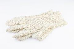 Women's gloves. White crocheted elegant women's gloves Royalty Free Stock Photo