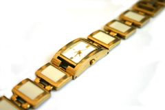Women's gold wristwatch Stock Photos