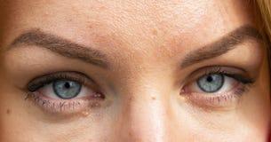 Women`s gray eyes look at close range stock images