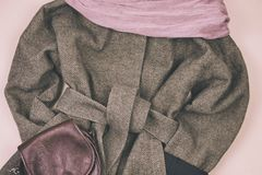 Women`s grey coat and many other women`s accessories around. Lifestyle stock images