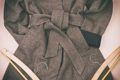 Women`s grey coat and many other women`s accessories around. Lifestyle stock image
