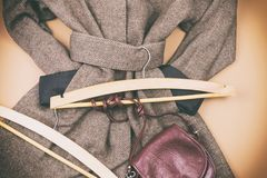 Women`s grey coat and many other women`s accessories around. Lifestyle royalty free stock photography