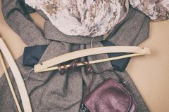 Women`s grey coat and many other women`s accessories around. Lifestyle royalty free stock image