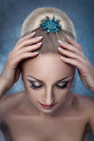 Women's hair with bobby pins. Women's hair gathered in bun and hairpin jewelry, the view from the top Royalty Free Stock Images