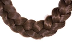 Women`s hair isolated on white background. A brown braid of hair.  Stock Photography