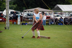 Women's Hammer throw. A Competitor in the women's hammer throw begins her wind-up, at the Cambridge Highland Games, Saturday July 18, 2009 royalty free stock photography