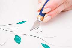 Women's hand cutting flower from paper Royalty Free Stock Image