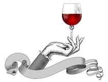Women`s hand holding a wine glass and ribbon isolated on white Stock Images