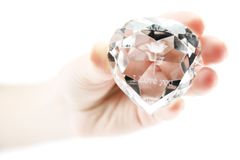 Women's hand holds crystal. With declaration of love isolated Royalty Free Stock Image