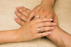 Women's hand on the male. In wedding day Royalty Free Stock Photo