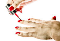 Women's hand painted nails red lacquer isolated Stock Photos