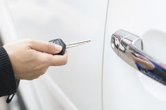 Women's hand presses on the car key remote Royalty Free Stock Images
