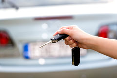 Women's hand presses on the remote control car alarm Stock Photos