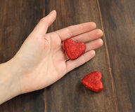 Women's hand with red heart Royalty Free Stock Photos